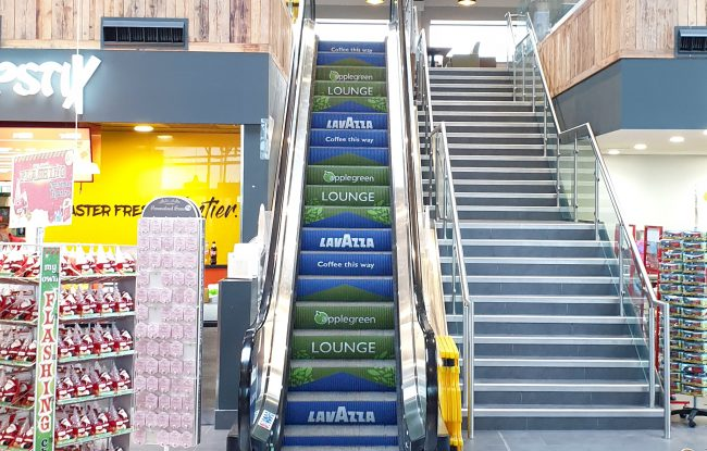 Applegreen Services Group escalator step branding campaign Northern Ireland