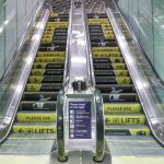 Network Rail escalator safety step branding campiagn Kings Cross Station London